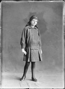 Full length portrait of a young girl modelling a d...