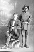 Full portrait of two men, Private Aki standing, Reg No 19232, Maori Contingent (11th Reinforcements - Rarotongans). New Zealand Maori Pioneer Battalion.