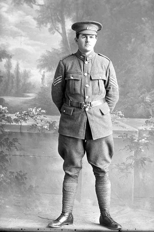 Full length portrait of Sergeant Ashton, probably Sergeant Norman Ashton, Reg No 24323, of the 17th Reinforcements, Auckland Infantry Regiment, J Company, (Corporal in the Roll of Honour), killed in action in France on 4 October 1917, at the Battle of Passchendaele. - Auckland Libraries