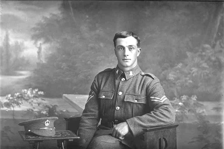 3/4 portrait of Corporal Henry Archibald Basil Cruller, Reg No 31401, of the 19th Reinforcements, J Company. Killed in action in France on 12 October 1917 at the Battle of Passchendaele. - Auckland Libraries