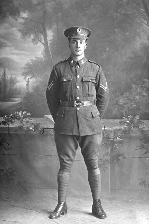 Full length portrait of Corporal Henry Archibald Basil Cruller, Reg No 31401, of the 19th Reinforcements, J Company. Killed in action in France on 12 October 1917 at the Battle of Passchendaele. - Auckland Libraries