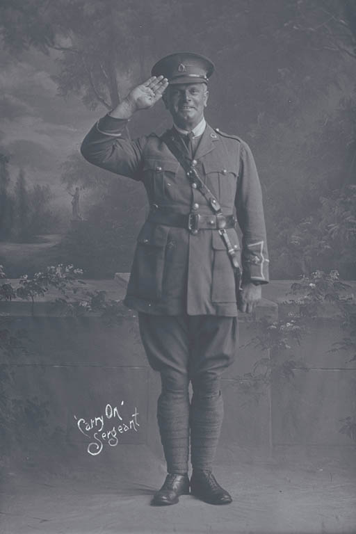 Full length portrait of Lieutenant Herbert Albert Edwin Milnes, Reg No 22525, of the 3rd (Auckland) Regiment, Auckland Infantry Regiment, Ships Adjutant of the 21st Reinforcements, Headquarters Staff. Killed in action in France on the 4th October 1917 at the Battle of Passchendaele. - Auckland Libraries