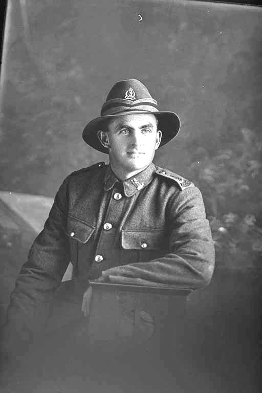 3/4 portrait of Rifleman Olds of the New Zealand Rifle Brigade, possibly Harold Olds, Reg No 46478, J Company. Killed in action in France on 12 October 1917 at the Battle of Passchendaele. - Auckland Libraries