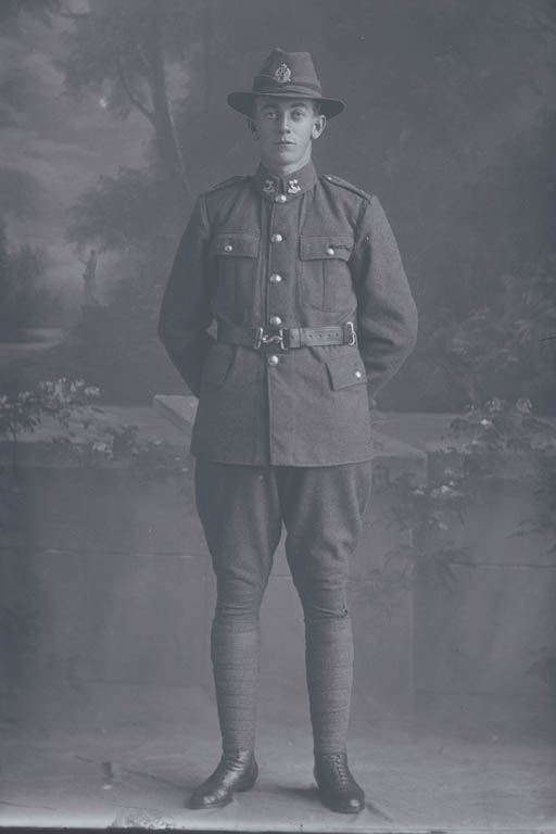 Full length portrait of Private Mark William Thompson, Reg No 15803, of the 15th Reinforcements, Wellington Infantry Battalion, - B Company, although his collar badges are of the 3rd (Auckland) Regiment. Later a Corporal, killed in action in France on 5 October 1917 at the Battle of Passchendaele. - Auckland Libraries