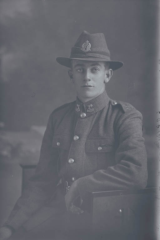 3/4 portrait of Private Mark William Thompson, Reg No 15803, of the 15th Reinforcements, Wellington Infantry Battalion, - B Company, although his collar badges are of the 3rd (Auckland) Regiment. Later a Corporal, killed in action in France on 5 October 1917 at the Battle of Passchendaele. - Auckland Libraries