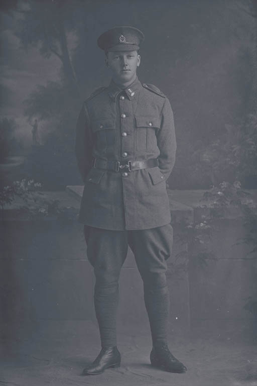 Full length portrait of Rifleman Frederick Charles Urwin, Reg No 18508, of the New Zealand Rifle Brigade, 6th Reinforcements to the 3rd Battalion, - G Company. Killed in action in France on 12 October 1917 at the Battle of Passchendaele. - Auckland Libraries