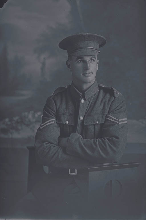 3/4 portrait of Corporal Norman Charles White, Reg No 7/2578, of the Canterbury Mounted Rifles, - C Squadron, New Zealand Mounted Rifles. (In the roll of honour a Lance Corporal with the Wellington Infantry Regiment), killed in action in France on 4 October 1917, at the Battle of Passchendaele. - Auckland Libraries