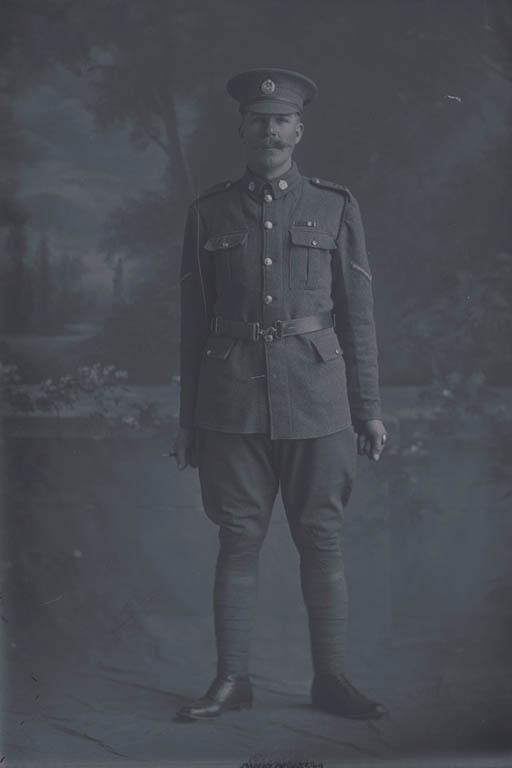 Full length portrait of Lance Corporal (Corporal in the nominal roll) Ralph White, Reg No 14518, of the Auckland Infantry Battalion, - A Company, 14th Reinforcements. Killed in action in France on 4 October 1917 at the Battale of Passchendaele. - Auckland Libraries