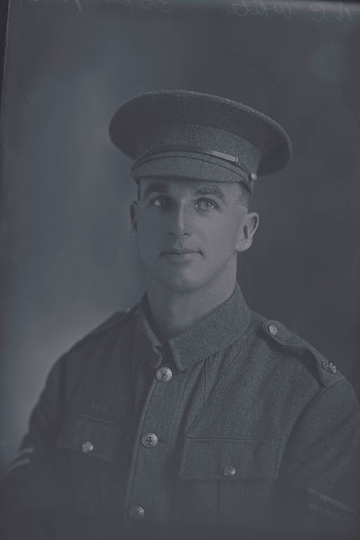 1/4 portrait of Corporal Norman Charles White, Reg No 7/2578, of the Canterbury Mounted Rifles, - C Squadron, New Zealand Mounted Rifles. (In the roll of honour a Lance Corporal with the Wellington Infantry Regiment), killed in action in France on 4 October 1917, at the Battle of Passchendaele. - Auckland Libraries
