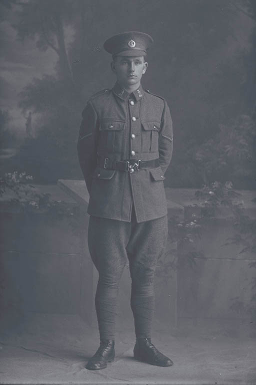 Full length portrait of Lance Corporal (Corporal in the nominal roll) Kenneth James Wallace, Reg No 15315, of the New Zealand Rifle Brigade, 9th Reinforcements to the 1st Battalion, - E Company. Killed in action in France on 12 October 1917 at the Battle of Passchendaele. - Auckland Libraries