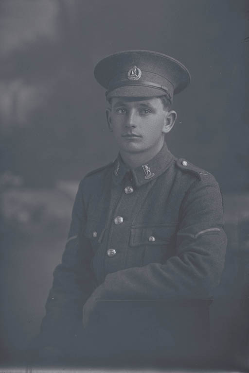 1/2 portrait of Lance Corporal (Corporal in the nominal roll) Kenneth James Wallace, Reg No 15315, of the New Zealand Rifle Brigade, 9th Reinforcements to the 1st Battalion, - E Company. Killed in action in France on 12 October 1917 at the Battle of Passchendaele. - Auckland Libraries