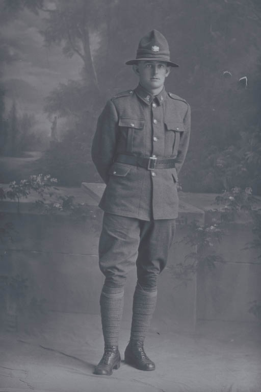 Full length portrait of Private Garfield Alexander Warin, Reg No 31752, of the Auckland Infantry Battalion, - A Company, 19th Reinforcements. Killed in action in France on 4 October 1917, at the Battle of Passchendaele. - Auckland Libraries