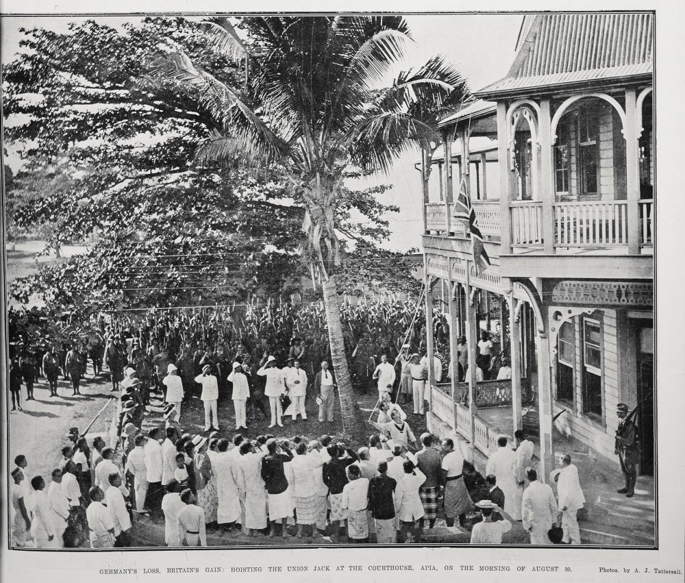 Germany's loss, Britain's gain: Hoisting the Union Jack at the courthouse Apia, on the morning of August 30. - Auckland Libraries