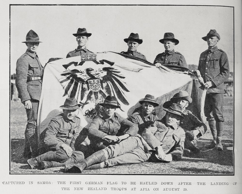 Captured in Samoa: The first German flag to be hauled down after the landing of the New Zealand troops at Apia on August 29. - Auckland Libraries
