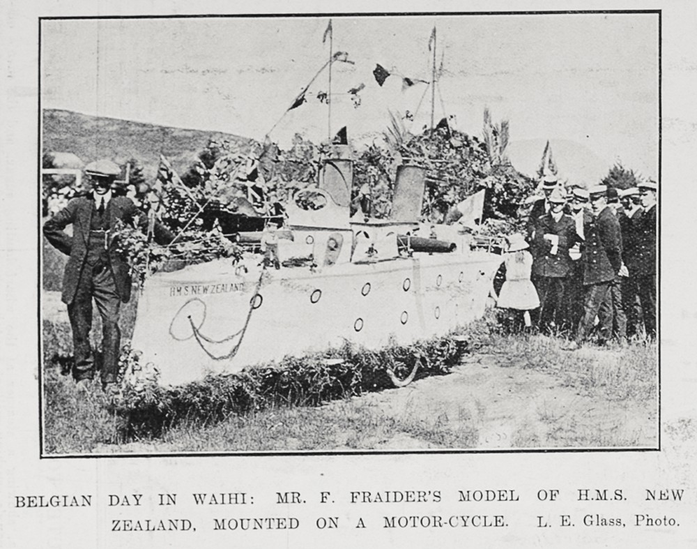 Belgian Day in Waihi: Mr F Fraider's model of H.M.S. New Zealand, mounted on a motorcycle. - Auckland Libraries