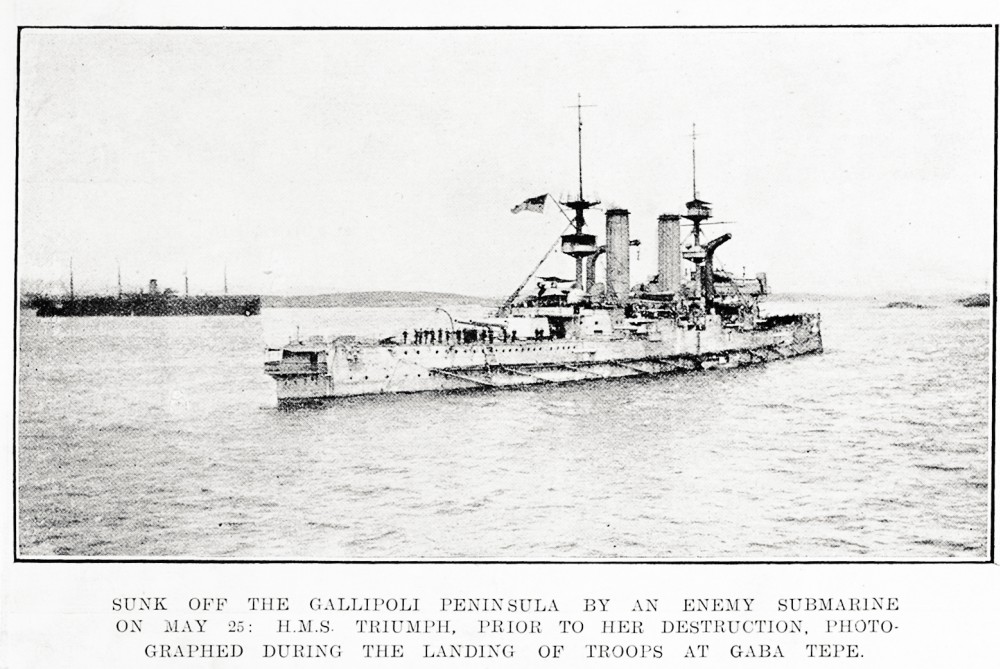 Sunk off the Gallipoli Peninsula by an enemy submarine on May 25: H.M.S. Triumph, prior to her destruction, photographed during the landing of troops at Gaba Tepe. - Auckland Libraries