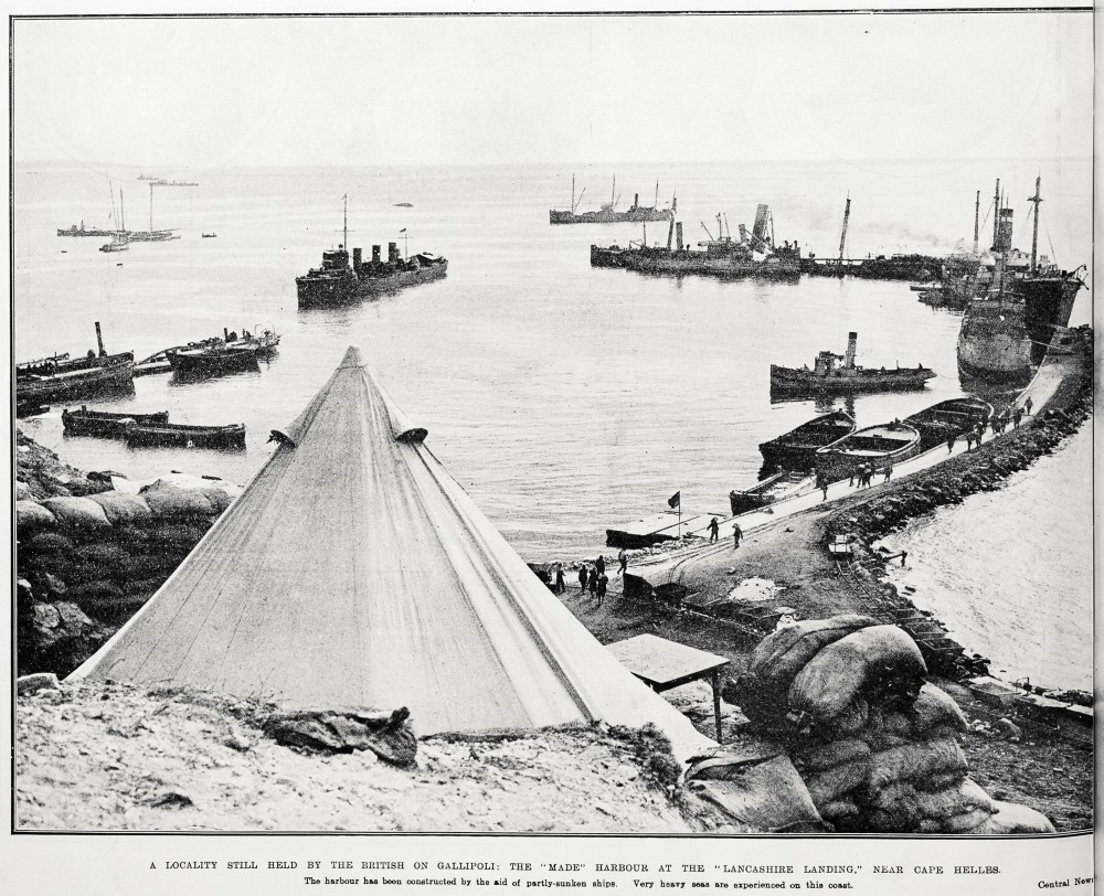 A locality still held by the British on Gallipoli: the 'made' harbour at the 'Lancashire landing,' near Cape Helles. The harbour has been constructed by the aid of partly-sunken ships. Very heavy seas are experienced on this coast. - Auckland Libraries