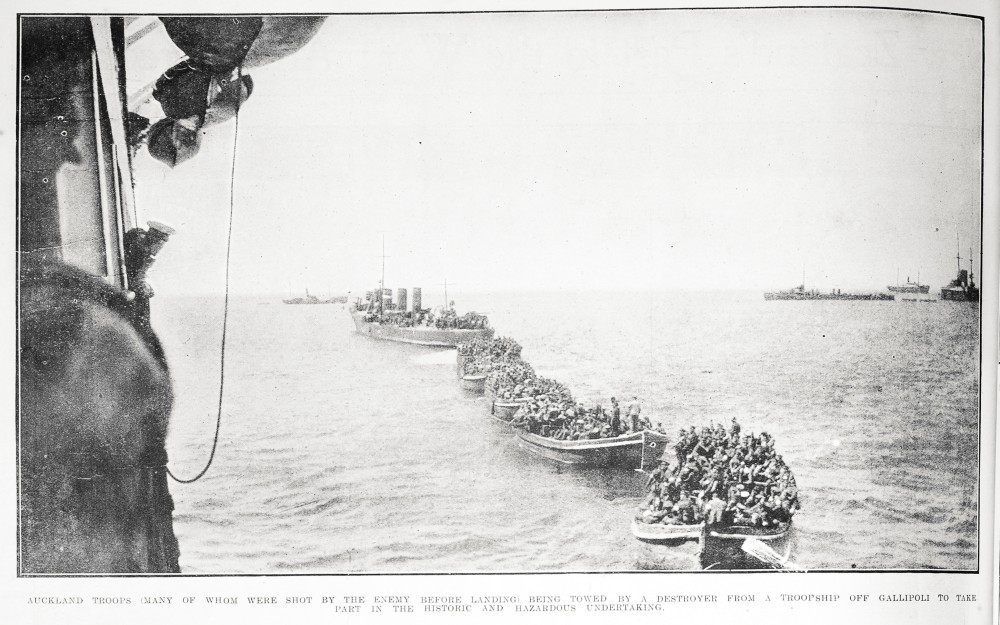 Auckland troops (many of whom were shot by the enemy before landing) being towed by a destroyer from a troopship off Gallipoli to take part in the historic and hazardous undertaking. - Auckland Libraries