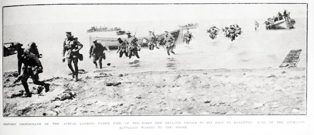 Historic photograph of the actual landing under fire of the first New Zealand troops to set foot on Gallipoli: some of the Auckland Battalion wading to the shore. - Auckland Libraries