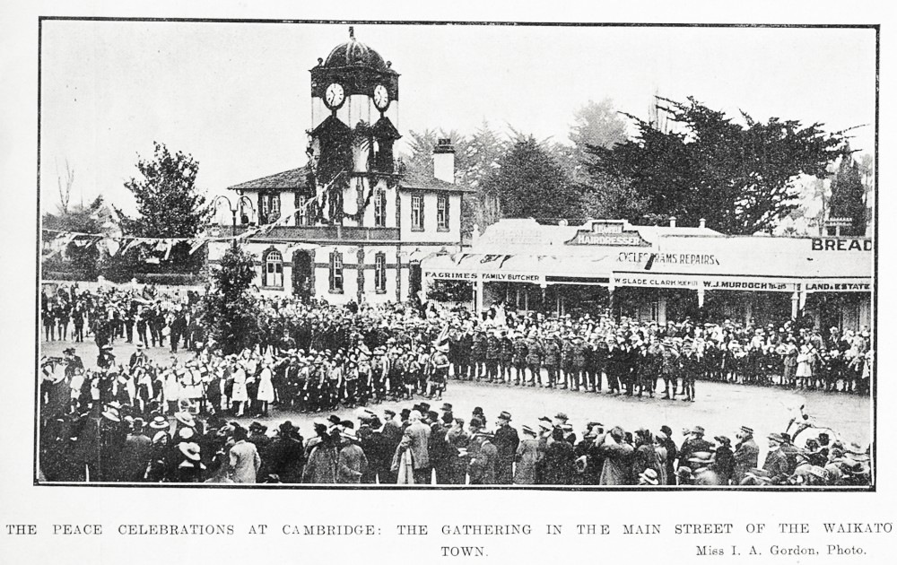 The peace celebrations at Cambridge: the gathering in the main street of the Waikato town. - Auckland Libraries