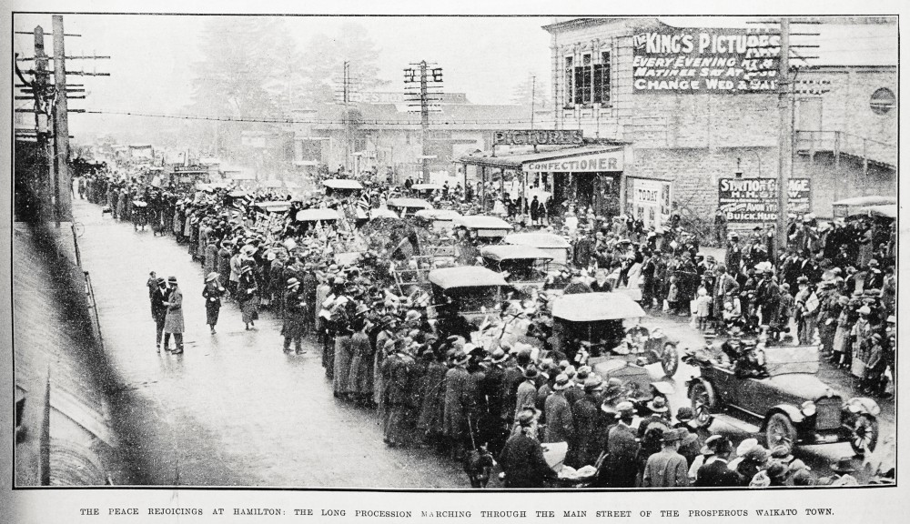 The peace rejoicings at Hamilton: the long procession marching through the main street of the prosperous Waikato town. - Auckland Libraries