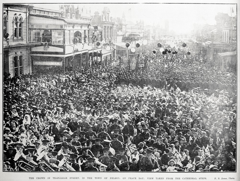 The crowd in Trafalgar Street, in the town of Nelson, on Peace Day: view taken from the Cathedral steps. - Auckland Libraries