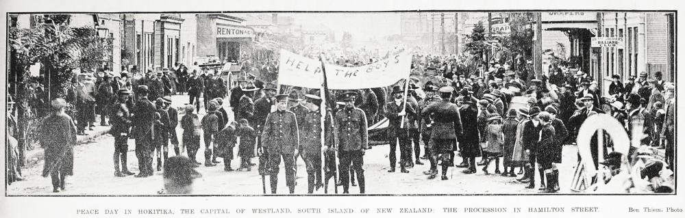 Peace day in Hokitika, the capital of Westland, South Island of New Zealand: the procession in Hamilton Street. - Auckland Libraries