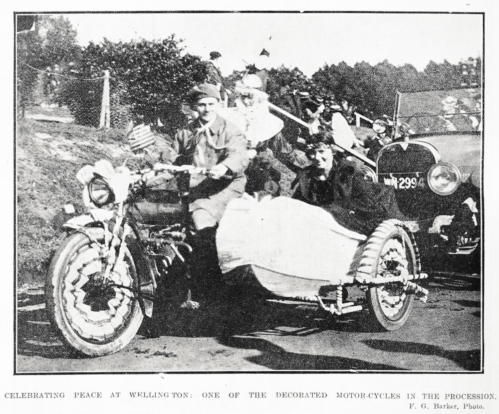 Celebrating peace at Wellington: one of the decorated motor-cycles in the procession. - Auckland Libraries