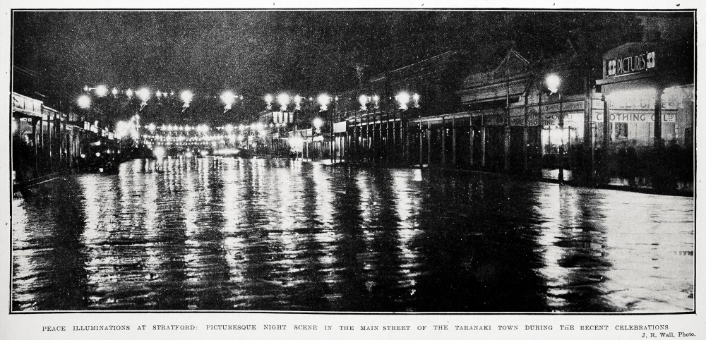 Peace illuminations at Stratford: picturesque night scene in the main street of the Taranaki town during the recent celebrations. - Auckland Libraries