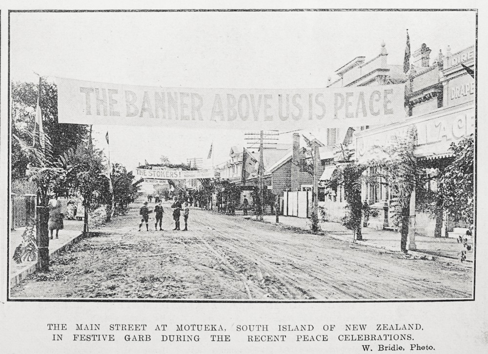 The main street at Motueka, South Island of New Zealand, in festive garb during the recent peace celebrations. - Auckland Libraries