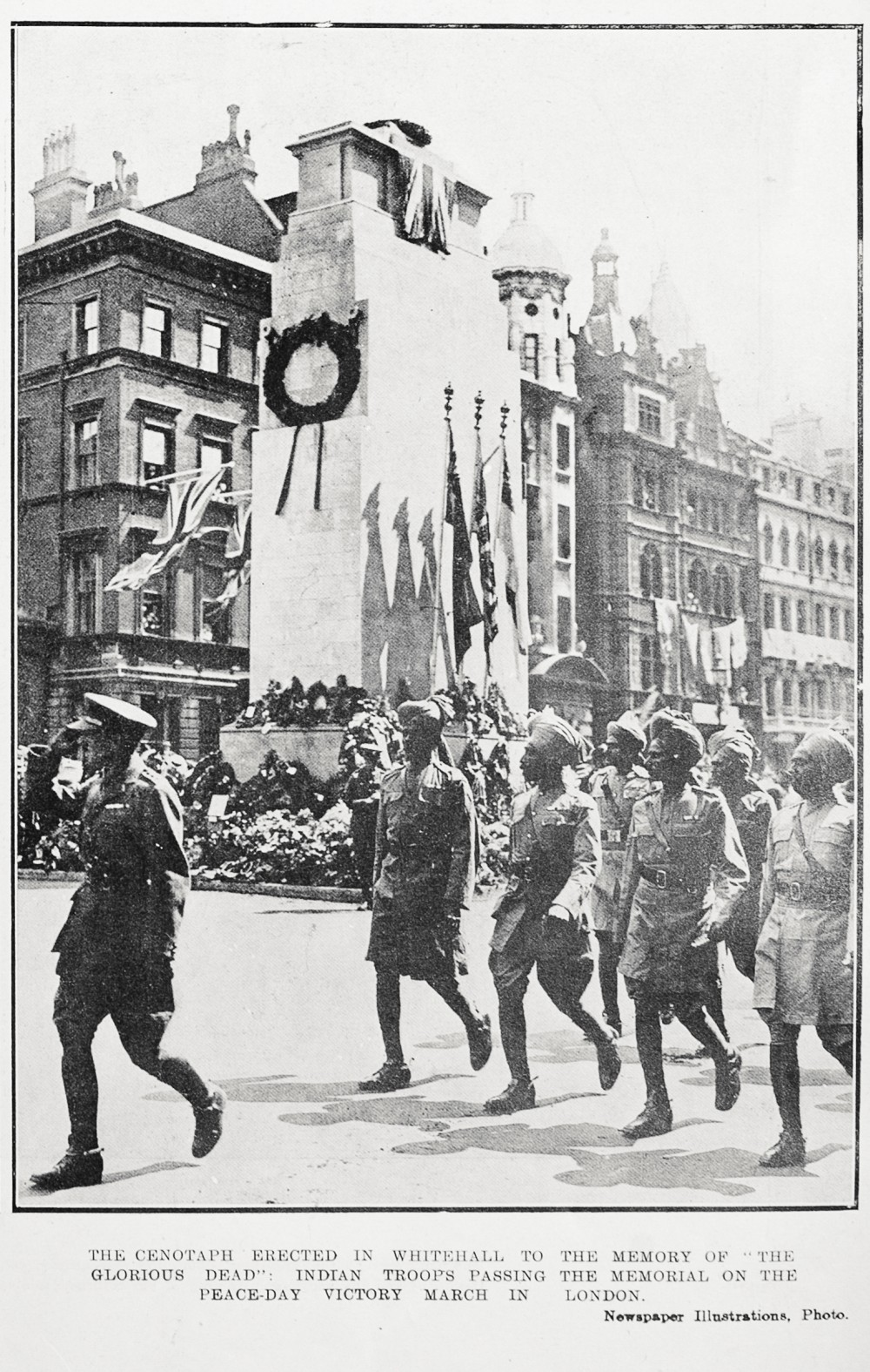 The cenotaph erected in Whitehall to the memory of 'The Glorious Dead': Indian troops passing the memorial on the peace-day victory march in London. - Auckland Libraries